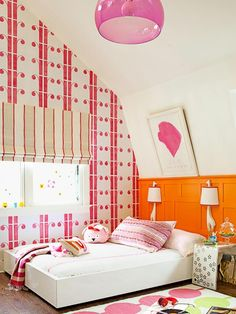 Interesting sloped ceiling bedroom - pink and orange girls room, wainscot, art placement. House Tours: A Colorful Cottage : Decorating : Home Garden Television