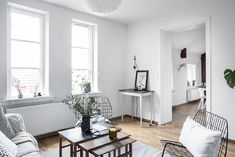 Bright modern interiors juxtapose beautifully with wooden accents and floors!