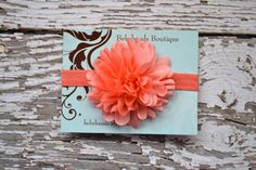 love this coral silk flower headband for baby girl