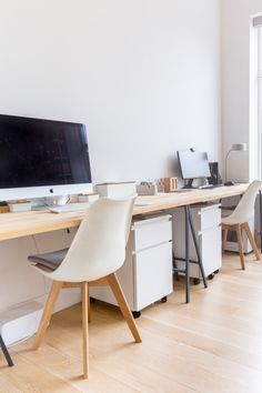 The desk was originally an IKEA countertop, but the two 'hacked' it by adding legs to create a desk. Eva and Ian each have their own space at the desk, which spans the entirety of one wall of their office.