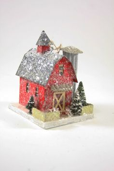 "An old red barn Christmas scene with silo. - Pressed paper putz barn with bottle brush trees and mica glitter. - 6"" H x 4"" W x 4.5"" D. - Imported."