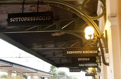 Signs at Assisi train station, Italy