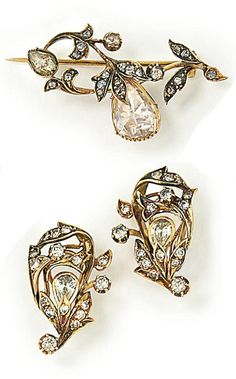 A VICTORIAN DIAMOND BROOCH AND A PAIR OF EARRINGS. The brooch designed as a rose-cut diamond openwork foliate spray with a central pear-shaped rose-cut diamond in a foiled closed-back mount, circa 1890, 4.1 cm; the earrings of similar design, set with circular-cut and pear-shaped diamonds, clip fittings, 2.6 cm. #Victorian #antique #brooch