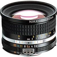 Nikon NIKKOR 20mm f/2.8 AIS Manual Focus Lens - Stick to prime lenses.  A 20mm and a 50mm, as fast as you can get them, will be your go-to lenses for 90% of what you shoot.  And the old manual lenses are made for shooting video.  (See if you can find one de-clicked.)