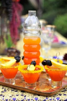 Jeweled Princess - mixture of Mango Juice, Grenadine, and Champagne. Dress it up with mango and blackberry on a bamboo skewer.