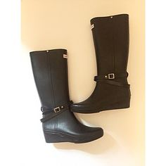"""Hunter Black Wedge Rain Boots Great way to brighten a rainy day in these black rubber rain boots by Hunter. Stylishly designed with a wedge heel and straps with buckle along the base of the shaft. In excellent pre-owned condition with no major scuffs. Measurements: outsole 10.5"""", width 3.25"""", opening circumference 14.5"""", total height 16.5"""", heel height 1.75"""". Hunter Boots Shoes Winter & Rain Boots"""