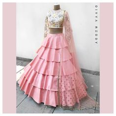 Crop top and a high waisted layered skirt is the easiest majestic outfit pick for summers. Would there be a need to mention that the two most favourite colour picks for this season ivory and blush pink team up to make it just perfect!ed 04 March 2018 Lehnga Dress, Lehenga Choli, Silk Dupatta, Sharara, Indian Wedding Outfits, Indian Outfits, Indian Designer Outfits, Designer Dresses, Indian Gowns Dresses