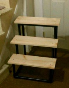Doggie steps...pvc pipe spray painted black an wood boards screwed in to pvc...way cheaper then petsmart.