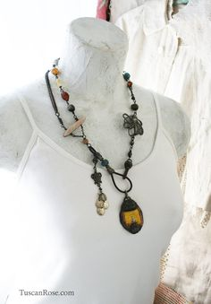 This necklace is an assemblage of many materials that include: shell, beads, lampwork beads, ghana glass beads, steel epoxy beadsm wire, metal