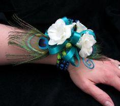 white freesia, peacock feathers, wire & ribbon