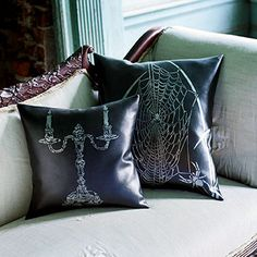 Black-and-Silver Halloween Throw Pillows - For eerie decor that screams Halloween, look for black faux leather to craft these throw pillows. The easy-to-find fabric is durable and inexpensive and can be dressed up with Halloween stencils and metallic paint.