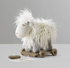 RH Baby & Child's Wooly Plush Pull Toy - Lamb:As your child grows, simple pull-along toys help nurture development. Ours feature our favorite Wooly Plush animals, paired with heirloom-quality details like a wooden base and wheels, natural rope pull string and a toggle handle.