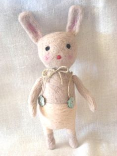 Needle felted bunny art toy by feltstories on Etsy.