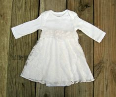 This ethereal little dress is the perfect wear-again choice for weddings, baptisms, baby dedications, christenings, or whatever special occasion your little one may have. Features a white rose lace overlay with lining built around a cotton bodysuit, which keeps baby feeling as good as she looks and covered with a built in diaper cover.  Matching shoes and accessories: https://www.etsy.com/shop/TheStorkShoppe?ref=hdr_shop_menu&section_id=19017603  Size guide: ...