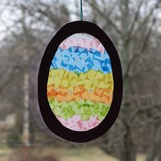 Easter Egg Sun Catcher This is a great project for kids of all ages. Theyll love how the light shines through the colored tissue paper! The post Easter Egg Sun Catcher was featured on Fun Family Crafts. Easter Crafts For Toddlers, Easy Easter Crafts, Easter Activities, Paper Crafts For Kids, Toddler Crafts, Easter Ideas, Kid Crafts, Easy Crafts, Bunny Crafts