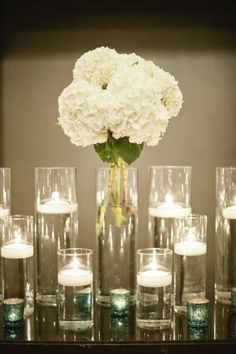 white carnation and votives for place card table