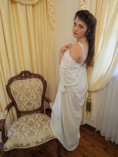 This is so sexy and elegant! This night gown is a see through chiffon-like material with flowing short sleeves and it is a classy long length that will make you look taller. It features gorgeous lace shoulders and trim on the sleeves. Perfect for a honeymoon/wedding night, Valentines Day or any night!  Made by Darly Size 46 Made in Lebanon approx. measurements Length from shoulder 146cm Shoulders 42cm Sleeve 51cm  THANKS FOR LOOKING!!! You can see our shop for other lovely vintage goodie...