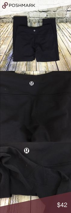 """Lululemon Black Wunder Under Crop Pants Lululemon Black Wunder Under Crop Pants Size 4 (size dot confirmed, no rip tag) Luon Hidden waistband pocket Wide, soft waistband (not roll-down) Four way Stretch  Measurements approximate: Waist: 12.5"""" Inseam: 23"""" Rise: 7.5"""" Leg opening: 5"""" Some overall light typical wear (light pulling between legs and on waistband). No holes, tears, or stains. lululemon athletica Pants"""