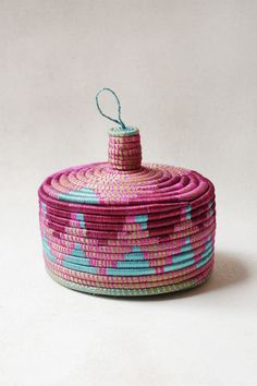 Coming from skilled Artisans in Rwanda, the vibrant and bright Marrakech basket is individually hand woven with precision and care. Bold, punchy design in a versatile size means this lidded basket wil Rope Basket, Basket Weaving, Hand Weaving, Zulu, Contemporary Baskets, Pine Needle Baskets, Art Storage, Craft Club, Basket Decoration