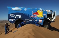 Dakar rally 2012 - Andrey Karginov of Russia and co-drivers Andrey Mokeev and Igor Devyatkin attempt to free their Kamaz truck after it became stuck on top of a sand dune during stage seven in Copiapo, Chile on January 7, 2012. (Bryn Lennon/Getty Images)