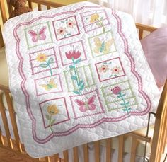 """$23.85-$37.99 Baby Baby: Stamped Cross Stitch: Crib Cover. The sweet sentiments, soft colors, and delicate designs of Bucilla's Baby Collection are sure to delight both the stitcher and the recipient! This kit contains 1 white poly/cotton pre-stamped, pre-quilted and pre-finished quilt, cotton floss, floss separator, needle, tri-lingual instructions and a chart. Quilt measures: 43"""" x 34"""". Design ..."""