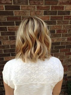 warm soft blond with a shattered bob hair cut