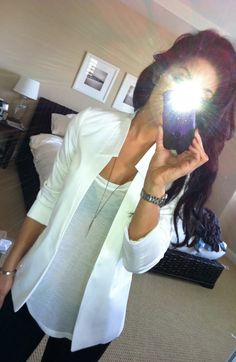 White blazer, gauzy tee, black skinnies or leather leggings.