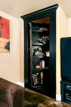Hidden door bookcase leads to basement storage would be cool for my closet in my living room (it just doesn't fit the decor)