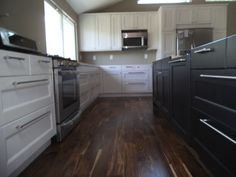 Ikea Ramsjo white and black cabinets. Tobacco road acacia flooring.