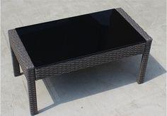 PE rattan glass modern coffe table black glass table top  http://enjoygroup.en.alibaba.com/product/60063728382-209347042/PE_rattan_glass_modern_coffe_table_black_glass_table_top.html