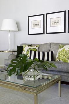 The Uncle Buck sofa looks great in a soft neutral gray. Love the addition of the different greens.