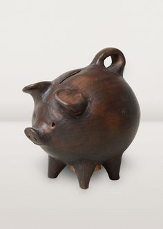 "This little clay pig is a ""chanchito,"" given to friends as a token of love and good fortune. Made with clay dug from the mountainside near the village of Pomaire, Chile."