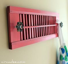 Use an old shutter a Use an old shutter and faucet hooks to make your own towel or apron rack.