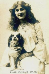 Phyllis Dare (1890 – 1975) who was famous for her performances in Edwardian musical comedy and gained international acclaim as Marta in Ivor Norvello's musical King's Rhapsody. in the early years of the last century many top stars often owned or were photographed with Cavalier type spaniels for their publicity photographs.