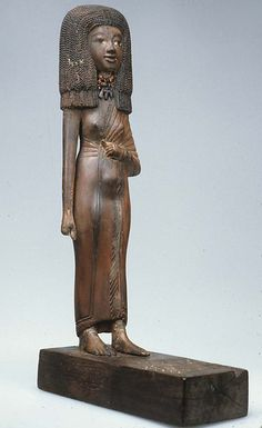 Statuette of the lady Tiye. Dynasty 18, reign of Amenhotep III–Akhenaten, ca. 1390–1349 B.C. Wood, carnelian, gold, glass, Egyptian blue, paint