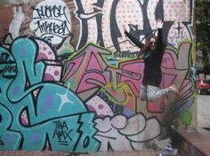 me jumping in San Telmo (Buenos Aires) against the background of some street art.