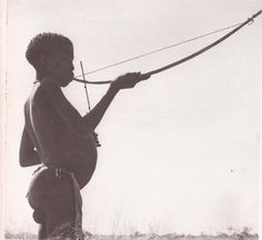 Bushman/ Koisan playing a hunting bow as a mouth bow Bow Hunting, Pyrography, Terra, South Africa, Silhouette, San, History, Music, African Tribes