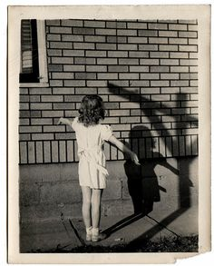 See more of my collection on Flickr,  enigmatic, girl with shadow cross, shadow, vintage snapshot,  funny, old photograph, strange, unusual vintage photo, weird vintage  wonderful, man with boat on his head