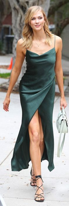 Who made Karlie Kloss' green wrap dress, lace up black sandals, and white handbag?