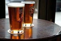 Two pints of beer on a table