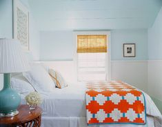 white bedding with a bold quilt for color