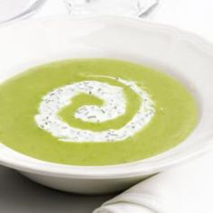 "Garden-Fresh Asparagus Soup  This lemony asparagus soup is spiced with a touch of curry and gets added richness from ""lite"" coconut milk and creamy red potatoes.  @eatingwell #asparagus"
