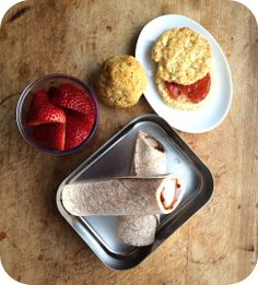 Easy lunch box ideas: barbecue chicken wrap; buttermilk biscuit with strawberry jam; sausage corn dog slider; and strawberries. http://www.L...