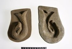 Carved limestone figure-mould, rectangular, used for making a glazed composition figure of an eagle-headed fish.