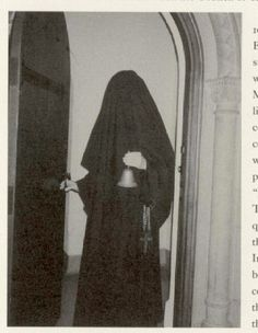 Carmelite nun with veiled face. Before the Vatican II Council the trademark of Catholic nuns used to be their habit, consisting of flowing robes and veils that covered the entire body, leaving only the face and hands visible.