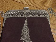 Lovely Old Purse, Black Fabric, Fancy Metal Frame, Tassel, Chain Handle. $22.50, via Etsy.