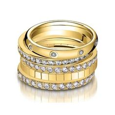 Gold & diamond stacking rings - one of these for our anniversary would sure look pretty with the wedding band and solitaire