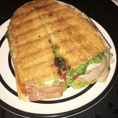 Prosciutto pesto sandwich with peppers and fontina