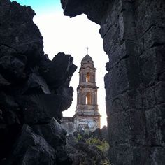 The ruins of Paricutin Mexico. Photo by @salvarezphoto (Stephen Alvarez) In 1943 lava from the erupting Paricutin volcano consumed the town of the same name leaving only the tower and part of the church nave as a reminder of the community that once stood here. The eruption itself lasted 9 years. Even though the volcano has been extinct since 1952 the lava field still steams in the cool early morning air. #lumiaxnatgeo #Mexico #Paricutin @lumiaxnatgeo by natgeo