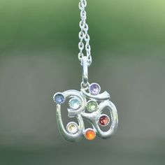 Om Symbol Seven 7 Chakras Charm on Silver tone chain Necklace with Amethyst, Iolite, Aquamarine, Peridot, Citrine, Carnelian, & Garnet by MayanRoseShop on Etsy